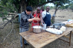 Visitors learning to prepare Maasai herbal soup